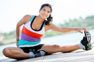 Woman stretching outdoors before starting her workout